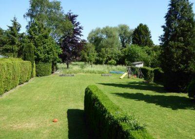 Tuin gezamenlijk gedeelte voorbij de heg